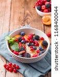 oatmeal porridge with fresh... | Shutterstock . vector #1168400044