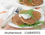 Liver fritters with pumpkin - stock photo