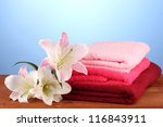 stack of towels with pink lily... | Shutterstock . vector #116843911