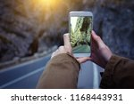 girl taking a photo on a... | Shutterstock . vector #1168443931