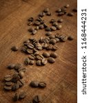 coffee beans on wood | Shutterstock . vector #1168444231