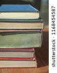 pile of old books on a wooden... | Shutterstock . vector #1168454587