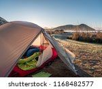 camping with tent near the sea   Shutterstock . vector #1168482577