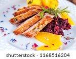 christmas roast duck served on... | Shutterstock . vector #1168516204