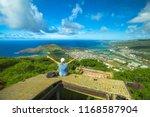 happy woman enjoying at top of... | Shutterstock . vector #1168587904