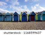 row of colourful by the sea in... | Shutterstock . vector #1168599637