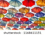 street decorated with colored... | Shutterstock . vector #1168611151