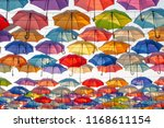 street decorated with colored... | Shutterstock . vector #1168611154