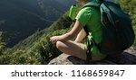 successful woman hiker drinking ... | Shutterstock . vector #1168659847