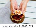 ripe sweet figs in a basket... | Shutterstock . vector #1168681024