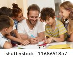 tutor sitting at table  writing ... | Shutterstock . vector #1168691857