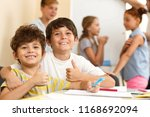 portrait of boys enjoying... | Shutterstock . vector #1168692094