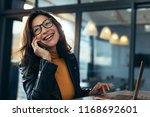 cheerful asian female talking...   Shutterstock . vector #1168692601