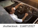close up of young man driving... | Shutterstock . vector #1168715527