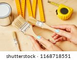 woman holding brushes to paint... | Shutterstock . vector #1168718551