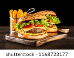 delicious grilled burgers | Shutterstock . vector #1168723177