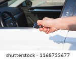 woman's hand presses button on... | Shutterstock . vector #1168733677
