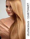 long blonde hair. beautiful... | Shutterstock . vector #1168734697