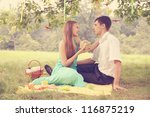 Woman gives a gift to his beloved man - stock photo