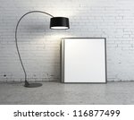 floor lamp and poster  in brick room - stock photo