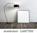 lamp and poster  in brick room - stock photo