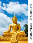 Small photo of beautiful golden buddha with blue sky in Thailand.For the background picture postcards advertising detrimental impacts on Buddhism.