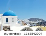church with blue roof at oia... | Shutterstock . vector #1168842004