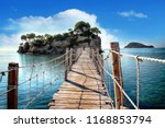 the wooden bridge overlooking... | Shutterstock . vector #1168853794