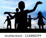 Running group of children silhouettes - stock photo