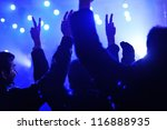 Concert crowd in front of bright stage lights - stock photo