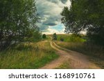 cloudy summer landscape with... | Shutterstock . vector #1168910761