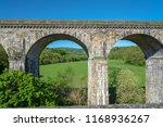 Small photo of View of the Chirk railway viaduct from a narrowboat on the Chirk Aquaduct. The later built Railway viaduct runs alongside the navigable aquaduct.