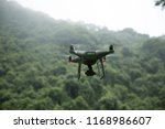 white drone with camera flying... | Shutterstock . vector #1168986607