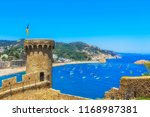 the fortress and bay of tossa... | Shutterstock . vector #1168987381
