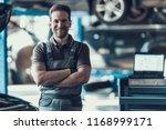 handsome smiling car machanic...   Shutterstock . vector #1168999171