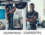 mechanics checking wheel... | Shutterstock . vector #1169000791