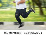 feet of obese woman doing... | Shutterstock . vector #1169062921