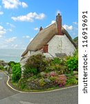 Thatched Cottage In A Fishing...
