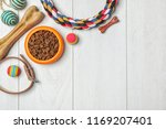Stock photo bowl with food for dog or cat and accessories on wooden background pet care 1169207401