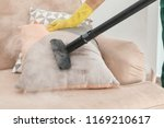 janitor removing dirt from sofa ... | Shutterstock . vector #1169210617