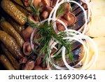 Stock photo potatoes onions cucumbers herring and mushrooms close up 1169309641