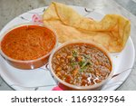 chole bhature an indian... | Shutterstock . vector #1169329564