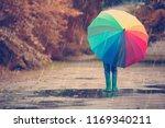 child walking in wellies in... | Shutterstock . vector #1169340211