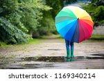 child walking in wellies in... | Shutterstock . vector #1169340214