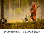 hunter and hunting dogs chasing ... | Shutterstock . vector #1169351524