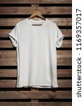 blank white t shirt hanging on... | Shutterstock . vector #1169357017