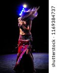 belly dancing in the middle of... | Shutterstock . vector #1169384737