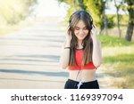 smiling teenage girl holding... | Shutterstock . vector #1169397094