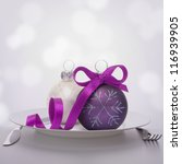 Christmas ball decoration on plate. Feast concept. - stock photo