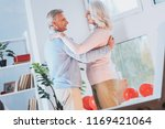 slow dance. attractive female... | Shutterstock . vector #1169421064